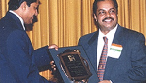 Dr. Majeed receiving the award for Entrepreneurial Excellence by Asian American Heritage Group in 1997